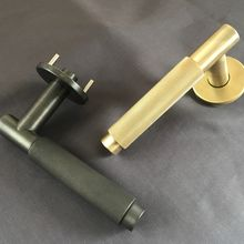 Brass knurled lever on rose- one satin one bronze